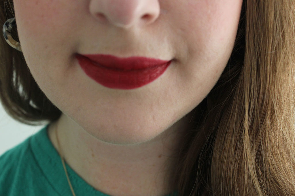 NARS Cruella velvet matte lip pencil on fair skin